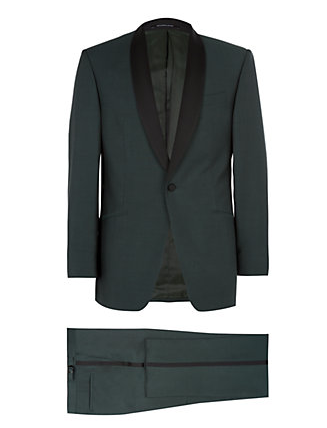 The tuxedo has undergone a transformation over the last few seasons, allowing for a more modern attitude to evening wear. This forest green interpretation of the classic look by Richard James is confident, sharp and contemporary. The perfect way to make a seasonally festive entrance.