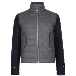 The biker jacket is a key style for AW13. Moncler's version offers a unique spin, with the contrast sleeves and popper and zip details. Incorporating the brand's iconic quilted details, it is a piece which will see you through the seasons.