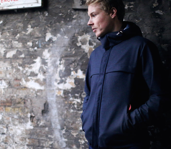 mens parka_outside old brick wall_web