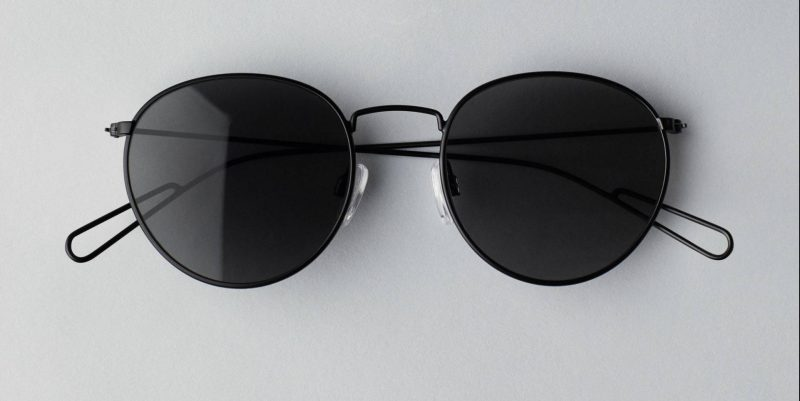9b07cc2a507 Explore Rounded Sunglasses are a pair of subtle round glasses in thin  metallic frames. They have a matte finish and black tinted lenses that are  perfect to ...